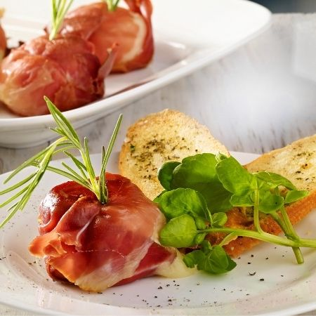 Goats Cheese Crottins Wrapped in Parma Ham with Rosemary
